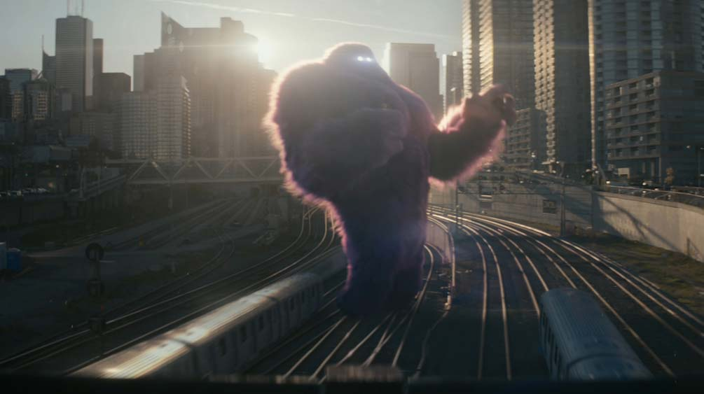 Monster.com monster carrying woman over railway line CGI